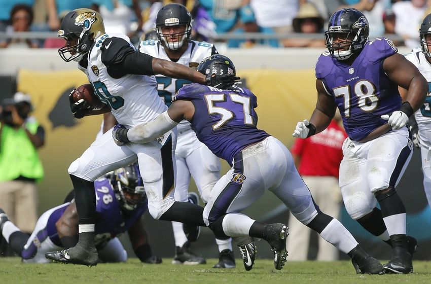 Sep 25, 2016; Jacksonville, FL, USA;  Baltimore Ravens inside linebacker C.J. Mosley (57) tackles Jacksonville Jaguars tight end Julius Thomas (80) in second half at EverBank Field. Baltimore Ravens won 19-17. Mandatory Credit: Logan Bowles-USA TODAY Sports