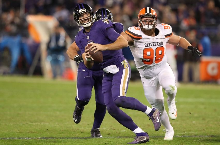 Nov 10, 2016; Baltimore, MD, USA;  Baltimore Ravens quarterback Joe Flacco (5) runs from defensive pressure from Cleveland Browns defensive lineman Jamie Meder (98) at M&T Bank Stadium. Mandatory Credit: Mitch Stringer-USA TODAY Sports
