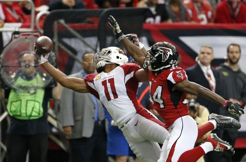 Nov 27, 2016; Atlanta, GA, USA; Arizona Cardinals wide receiver Larry Fitzgerald (11) makes a one handed catch against Atlanta Falcons cornerback Brian Poole (34) in the first quarter of their game at the Georgia Dome. Mandatory Credit: Jason Getz-USA TODAY Sports