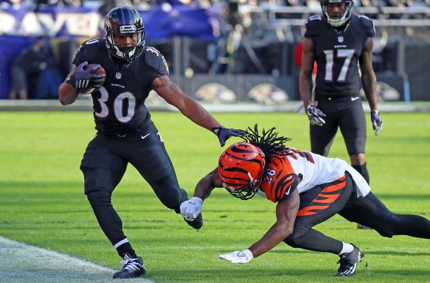 Nov 27, 2016; Baltimore, MD, USA; Baltimore Ravens running back Kenneth Dixon (30) is forced out of bounds on a run by Cincinnati Bengals cornerback Josh Shaw (26) at M&T Bank Stadium. Mandatory Credit: Mitch Stringer-USA TODAY Sports