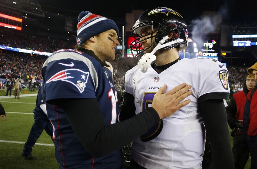 Jan 10, 2015; Foxborough, MA, USA; New England Patriots quarterback Tom Brady (12) talks to Baltimore Ravens quarterback Joe Flacco (5) after their 2014 AFC Divisional playoff football game at Gillette Stadium. The Patriots won 35-31. Mandatory Credit: Winslow Townson-USA TODAY Sports