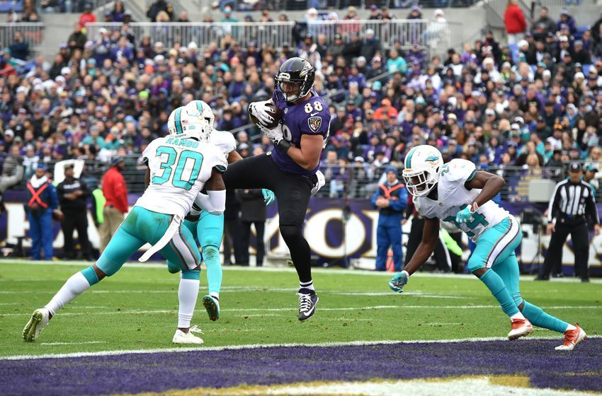 Dec 4, 2016; Baltimore, MD, USA;  Baltimore Ravens tight end Dennis Pitta (88) catches pass for a touchdown from quarterback Joe Flacco (not pictured) in front of Miami Dolphins free safety Bacarri Rambo (30) and linebacker Spencer Paysinger (42) during the first quarter at M&T Bank Stadium. Mandatory Credit: Tommy Gilligan-USA TODAY Sports
