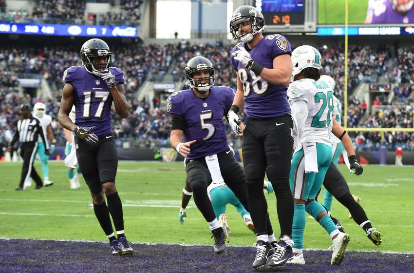 Dec 4, 2016; Baltimore, MD, USA;  Baltimore Ravens tight end Dennis Pitta (88) celebrates with  quarterback Joe Flacco (5) and wide receiver Mike Wallace (17) after scoring a touchdown during the second quarter against the Miami Dolphins at M&T Bank Stadium. Mandatory Credit: Tommy Gilligan-USA TODAY Sports