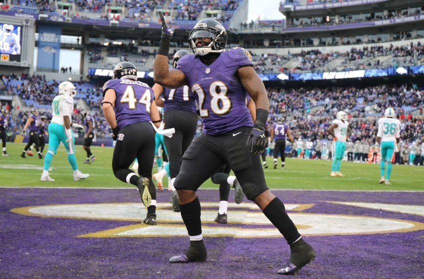 Dec 4, 2016; Baltimore, MD, USA; Baltimore Ravens running back Terrance West (28) blows a kiss to the fans after his fourth quarter touchdown against the Miami Dolphins at M&T Bank Stadium. Mandatory Credit: Mitch Stringer-USA TODAY Sports