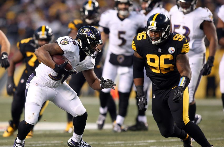 Dec 25, 2016; Pittsburgh, PA, USA; Baltimore Ravens running back Kenneth Dixon (30) runs after a catch against Pittsburgh Steelers defensive tackle L.T. Walton (96) during the first quarter at Heinz Field. Mandatory Credit: Charles LeClaire-USA TODAY Sports