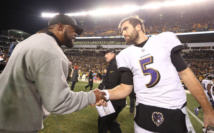 Dec 25, 2016; Pittsburgh, PA, USA;  Pittsburgh Steelers head coach Mike Tomlin (left) shakes hands with Baltimore Ravens quarterback Joe Flacco (5) after their game at Heinz Field. The Steelers won 31-27. Mandatory Credit: Charles LeClaire-USA TODAY Sports