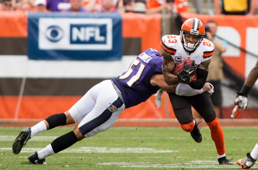 Sep 18, 2016; Cleveland, OH, USA; Cleveland Browns cornerback Joe Haden (23) gets hit by Baltimore Ravens linebacker Kamalei Correa (51) while returning a punt during the third quarter at FirstEnergy Stadium. The Ravens defeated the Browns 25-20. Mandatory Credit: Scott R. Galvin-USA TODAY Sports