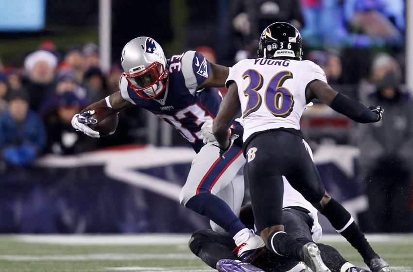 Dec 12, 2016; Foxborough, MA, USA; New England Patriots running back Dion Lewis (33) rushes against Baltimore Ravens cornerback Tavon Young (36) during the second half at Gillette Stadium. Mandatory Credit: Stew Milne-USA TODAY Sports