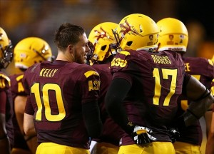 Sep 5, 2013; Tempe, AZ, USA; Arizona State Sun Devils quarterback Taylor Kelly (10) talks with tight end Darwin Rogers (17) against the Sacramento State Hornets in the second half at Sun Devil Stadium. Mandatory Credit: Mark J. Rebilas-USA TODAY Sports