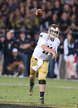 Sep 14, 2013; West Lafayette, IN, USA; Notre Dame Fighting Irish quarterback Tommy Rees (11) throws a pass against the Purdue Boilermakers at Ross Ade Stadium. Mandatory Credit: Brian Spurlock-USA TODAY Sports