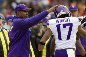 Dec 22, 2013; Cincinnati, OH, USA; Minnesota Vikings head coach Leslie Frazier congratulates wide receiver Jarius Wright (17) on his touchdown catch in the first quarter of the game against the Cincinnati Bengals at Paul Brown Stadium. Cincinnati Bengals beat the Minnesota Vikings by the score of 42-14. Mandatory Credit: Trevor Ruszkowksi-USA TODAY Sports