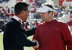 Oklahoma head coach Bob Stoops (at right) and Oklahoma State coach Mike Gundy shake hands prior to last season's Bedlam game at Oklahoma.