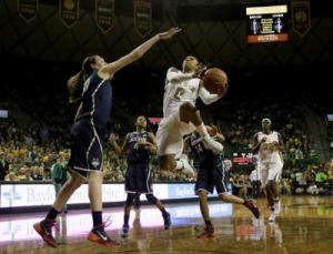 Baylor senior guard Odyssey Sims (in white) isthe country's leading scorer in women's basketball, averaging over 30 points per game.