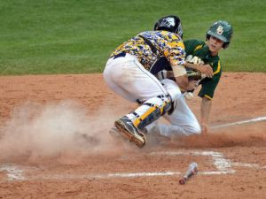 Baylor broke up a 2-2 tie against West Virginia with a five-run seventh inning and went on to down the Mountaineers 9-4 to remain alive in the Big 12 Baseball Championship.