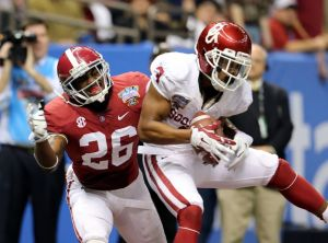 Jan 2, 2014; New Orleans, LA, USA; Oklahoma Sooners wide receiver Sterling Shepard (3) makes a touchdown catch in front of Alabama Crimson Tide defensive back Landon Collins (26) during the fourth quarter of the Sugar Bowl at the Mercedes-Benz Superdome. Mandatory Credit: Chuck Cook-USA TODAY Sports