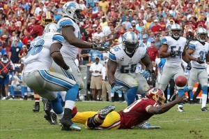Robert Griffin III (above) watches as a crucial fumble slips just out of his grasp