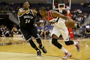 Oct 8, 2013; Washington, DC, USA; Washington Wizards small forward Trevor Ariza (1) dribbles the ball as Brooklyn Nets small forward Paul Pierce (34) defends in the first quarter at Verizon Center. Mandatory Credit: Geoff Burke-USA TODAY Sports