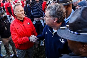 Georgia Tech coach Paul Johnson shakes hands with Georgia's coach Mark Richt after the old-fashion hatred game on Nov 24, 2012
