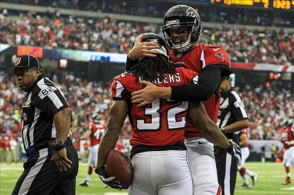 Oct 20, 2013; Atlanta, GA, USA; Atlanta Falcons running back Jacquizz Rodgers (32) celebrates a touchdown with quarterback Matt Ryan (2) in the first half against the Tampa Bay Buccaneers at the Georgia Dome. Mandatory Credit: Daniel Shirey-USA TODAY Sports