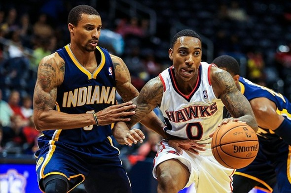 Oct 22, 2013; Atlanta, GA, USA; Atlanta Hawks point guard Jeff Teague (0) drives past Indiana Pacers point guard George Hill (3) towards the basket in the first half at Philips Arena. Mandatory Credit: Daniel Shirey-USA TODAY Sports
