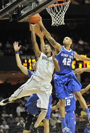 Nov 12, 2013; Nashville, TN, USA; Georgia State Panthers forward Curtis Washington (42) blocks a shot attempt by Vanderbilt Commodores guard Eric McClellan (1) during the second half at Memorial Gym. Vanderbilt won 86-80. Mandatory Credit: Jim Brown-USA TODAY Sports