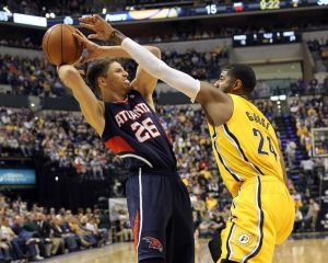 Apr 6, 2014; Indianapolis, IN, USA; Indiana Pacers forward Paul George (24) plays defense against Atlanta Hawks guard Kyle Korver (26) during the first quarter at Bankers Life Fieldhouse. Mandatory Credit: Pat Lovell-USA TODAY Sports