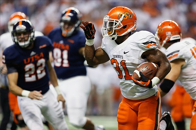 Sep 7, 2013; San Antonio, TX, USA; Oklahoma State Cowboys running back Smith, Jeremy (31) runs with the ball against the Texas-San Antonio Roadrunners during the first half at Alamodome. Mandatory Credit: Soobum Im-USA TODAY Sports