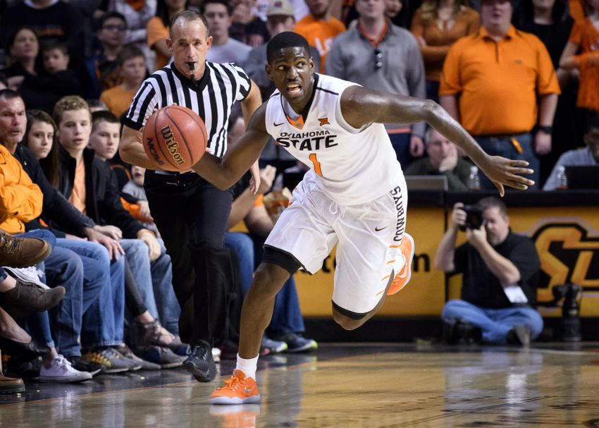 9777451-ncaa-basketball-west-virginia-oklahoma-state