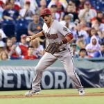 Jul 25, 2014; Philadelphia, PA, USA; Arizona Diamondbacks third baseman Martin Prado (14) fields a ground ball in a game against the Philadelphia Phillies at Citizens Bank Park. Mandatory Credit: Bill Streicher-USA TODAY Sports