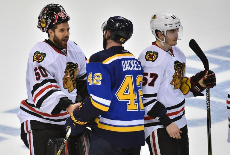 Corey-crawford-david-backes-nhl-stanley-cup-playoffs-chicago-blackhawks-st.-louis-blues-768x518