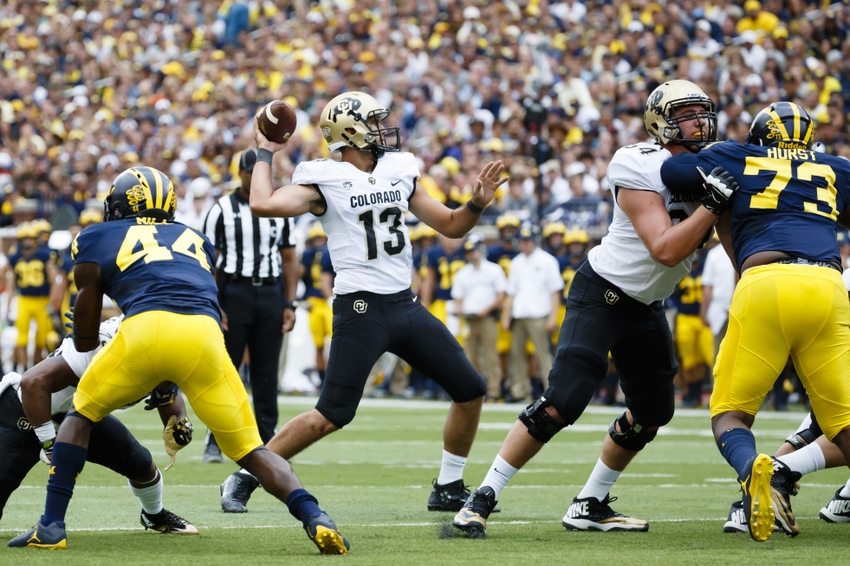 9545566-ncaa-football-colorado-michigan
