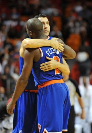 Dec 6, 2012; Miami FL, USA; New York Knicks point guard Pablo Prigioni (9) and point guard Raymond Felton (2) both celebrate their 112 to 92 win over the Miami Heat at American Airlines Arena. Mandatory Credit: Steve Mitchell-USA TODAY Sports