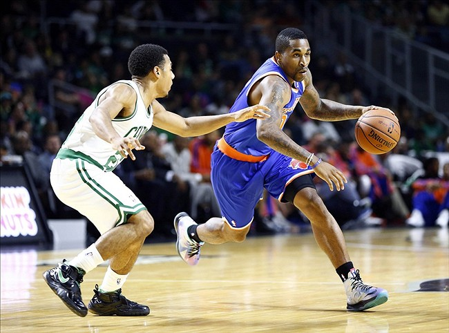 Oct 9, 2013; Providence, RI, USA; New York Knicks point guard Chris Smith (0) dibbles the ball against Boston Celtics point guard Phil Pressey (26) during the second half at Dunkin Donuts Center. Mandatory Credit: Mark L. Baer-USA TODAY Sports