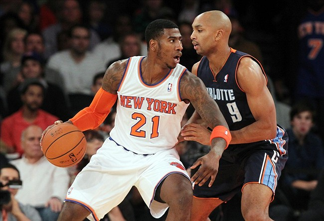 Oct 25, 2013; New York, NY, USA; New York Knicks shooting guard Iman Shumpert (21) controls the ball against Charlotte Bobcats shooting guard Gerald Henderson (9) during the first quarter of a preseason game at Madison Square Garden. Mandatory Credit: Brad Penner-USA TODAY Sports