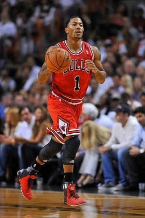 Oct 29, 2013; Miami, FL, USA; Chicago Bulls point guard Derrick Rose (1) dribbles during the first quarter against the Miami Heat at American Airlines Arena. Mandatory Credit: Steve Mitchell-USA TODAY Sports