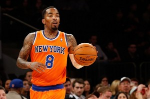 Dec 1, 2013; New York, NY, USA; New York Knicks shooting guard J.R. Smith (8) advances the ball during the first quarter against the New Orleans Pelicans at Madison Square Garden. Mandatory Credit: Anthony Gruppuso-USA TODAY Sports