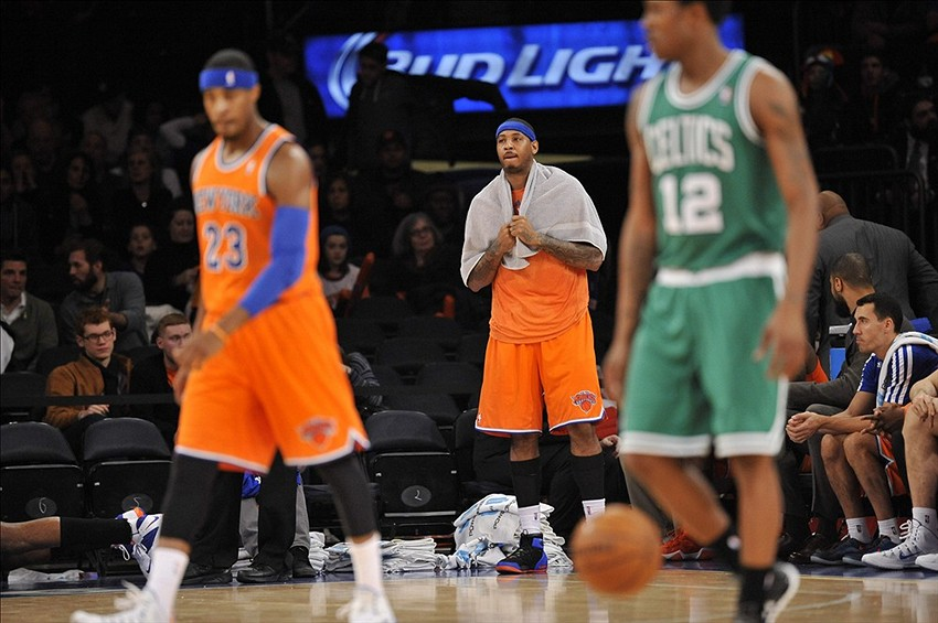 Dec 8, 2013; New York, NY, USA; New York Knicks small forward Carmelo Anthony (7) looks on against the Boston Celtics during the second half at Madison Square Garden. The Celtics won the game 114-73. Mandatory Credit: Joe Camporeale-USA TODAY Sports