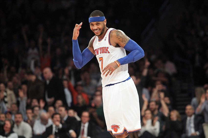 Jan 13, 2014; New York, NY, USA; New York Knicks small forward Carmelo Anthony (7) reacts after hitting a three-point shot against the Phoenix Suns during the first quarter of a game at Madison Square Garden. Mandatory Credit: Brad Penner-USA TODAY Sports