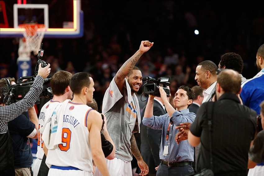 Jan 24, 2014; New York, NY, USA; New York Knicks small forward Carmelo Anthony (7) reacts after scoring 62 points against the Charlotte Bobcats at Madison Square Garden. Mandatory Credit: Noah K. Murray-USA TODAY Sports
