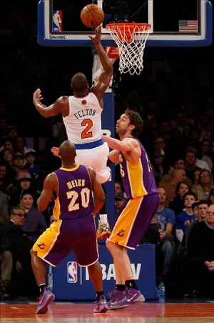 Jan 26, 2014; New York, NY, USA; New York Knicks point guard Raymond Felton (2) shoots the ball during the first quarter against the Los Angeles Lakers at Madison Square Garden. Mandatory Credit: Anthony Gruppuso-USA TODAY Sports