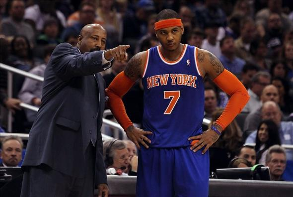 January 5, 2013; Orlando FL, USA; New York Knicks head coach Mike Woodson talks with small forward Carmelo Anthony (7) during the second quarter at Amway Center. Mandatory Credit: Kim Klement-USA TODAY Sports