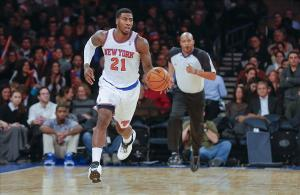 Dec 16, 2013; New York, NY, USA; New York Knicks shooting guard Iman Shumpert (21) brings the ball up court during the second half against the Washington Wizards at Madison Square Garden. Washington Wizards defeat the New York Knicks 102-101. Mandatory Credit: Jim O