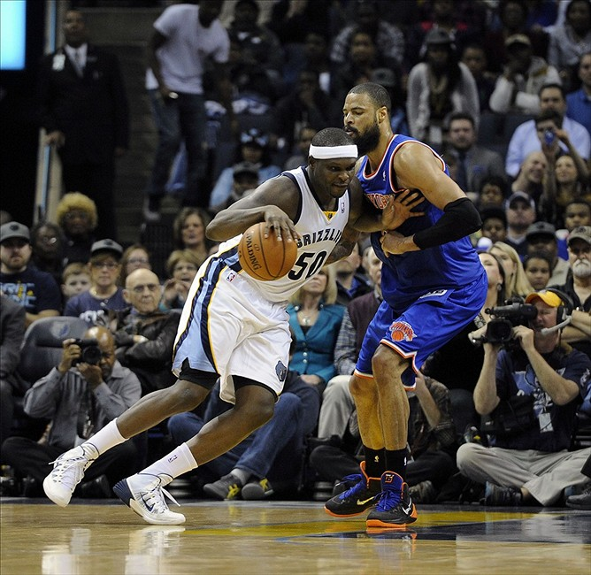 Feb 18, 2014; Memphis, TN, USA; Memphis Grizzlies power forward Zach Randolph (50) drives to the basket against New York Knicks center Tyson Chandler (6) during the game at FedExForum. Memphis Grizzlies beat New York Knicks 98 - 93. Mandatory Credit: Justin Ford-USA TODAY Sports