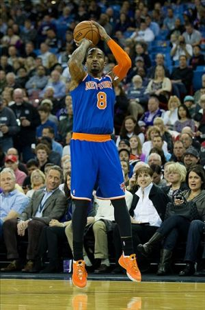 Mar 26, 2014; Sacramento, CA, USA; New York Knicks guard J.R. Smith (8) scores a three point basket against the Sacramento Kings during the first quarter at Sleep Train Arena. Mandatory Credit: Kelley L Cox-USA TODAY Sports