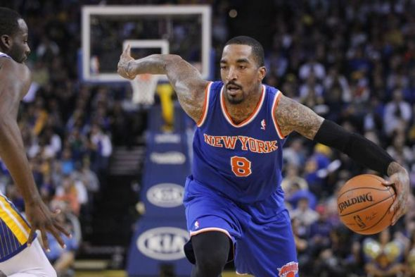 Mar 30, 2014; Oakland, CA, USA; New York Knicks guard J.R. Smith (8) dribbles the ball against the Golden State Warriors in the second quarter at Oracle Arena. Mandatory Credit: Cary Edmondson-USA TODAY Sports