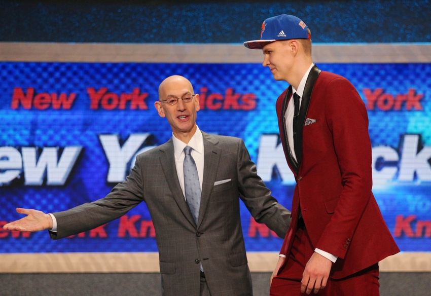 Jun 25, 2015; Brooklyn, NY, USA; Kristaps Porzingis is escorted onto the stage with NBA commissioner Adam Silver after being selected as the number four overall pick to the New York Knicks in the first round of the 2015 NBA Draft at Barclays Center. Mandatory Credit: Brad Penner-USA TODAY Sports