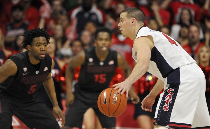 Mar 7, 2015; Tucson, AZ, USA; Arizona Wildcats guard T.J. McConnell (4) dribbles the ball as he is defended by Stanford Cardinal guard Chasson Randle (5) during the first half at McKale Center. Mandatory Credit: Casey Sapio-USA TODAY Sports