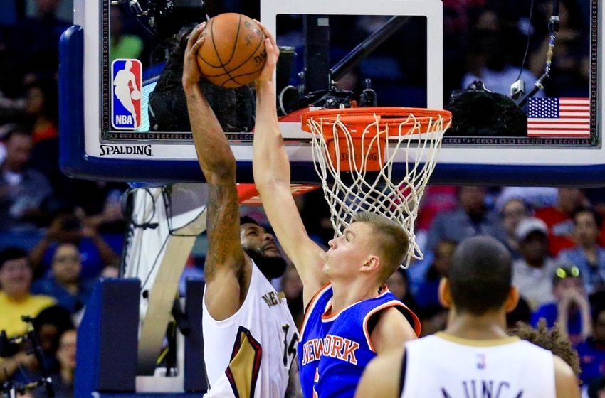Mar 28, 2016; New Orleans, LA, USA; New York Knicks forward Kristaps Porzingis (6) blocks a dunk attempt by New Orleans Pelicans forward Alonzo Gee (15) during the second quarter of a game at the Smoothie King Center. Mandatory Credit: Derick E. Hingle-USA TODAY Sports