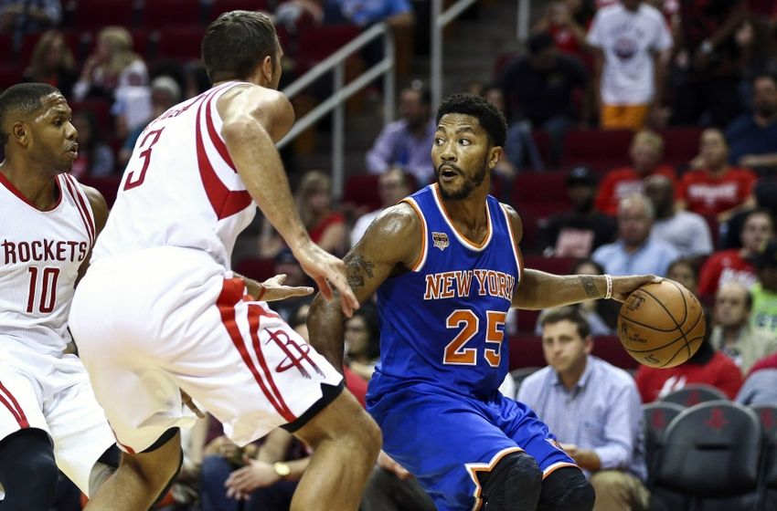 Oct 4, 2016; Houston, TX, USA; New York Knicks guard Derrick Rose (25) dribbles the ball as Houston Rockets forward Ryan Anderson (3) defends during the third quarter at Toyota Center. The Rockets won 130-103. Mandatory Credit: Troy Taormina-USA TODAY Sports