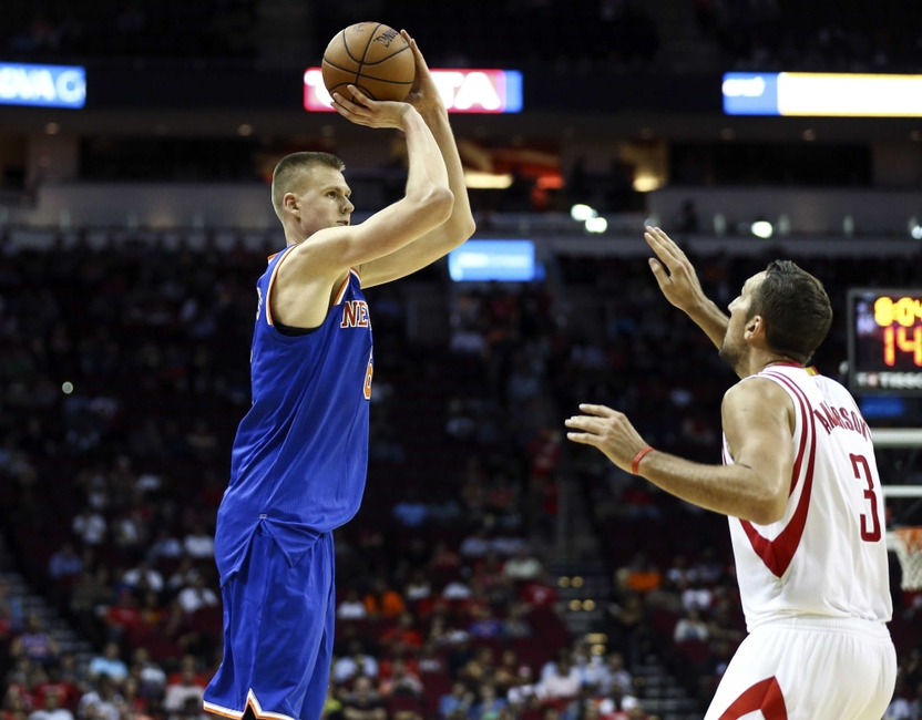 Oct 4, 2016; Houston, TX, USA; New York Knicks forward Kristaps Porzingis (6) shoots the ball over Houston Rockets forward Ryan Anderson (3) during the third quarter at Toyota Center. The Rockets won 130-103. Mandatory Credit: Troy Taormina-USA TODAY Sports
